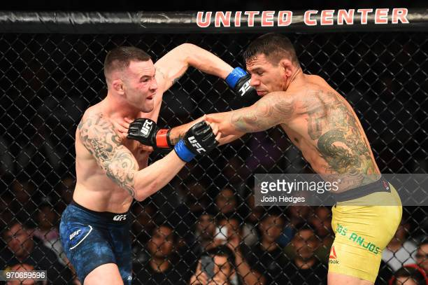 Colby Covington punches Rafael Dos Anjos of Brazil in their interim welterweight title fight during the UFC 225 event at the United Center on June 9,...