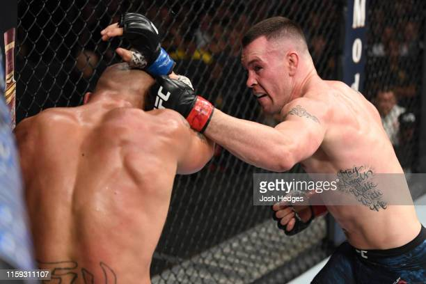 Colby Covington punches Robbie Lawler in their welterweight bout during the UFC Fight Night event at the Prudential Center on August 3, 2019 in...