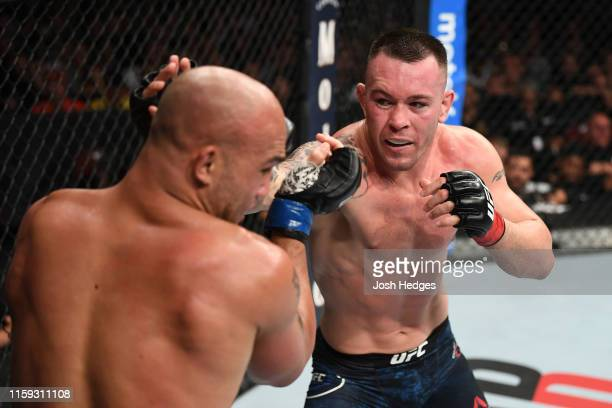 Colby Covington punches Robbie Lawler in their welterweight bout during the UFC Fight Night event at the Prudential Center on August 3 2019 in Newark...