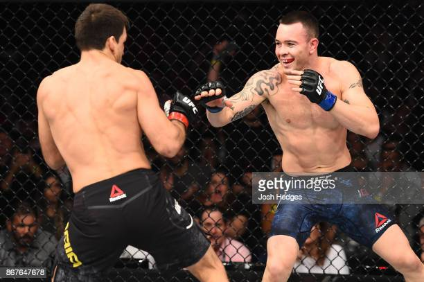 Colby Covington reacts to Demian Maia of Brazil in their welterweight bout during the UFC Fight Night event inside the Ibirapuera Gymnasium on...