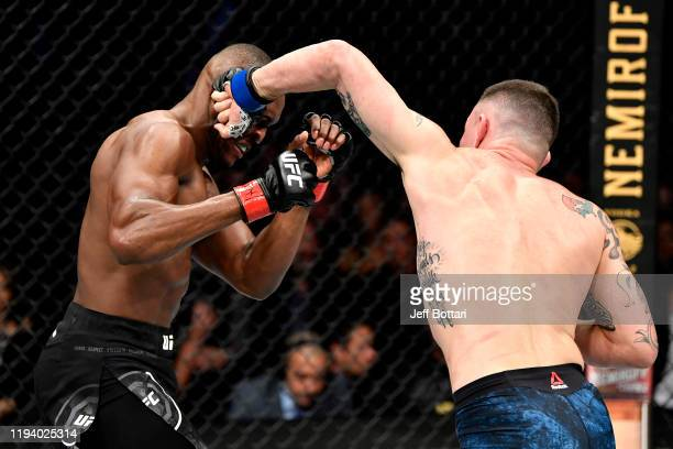 Colby Covington strikes Kamaru Usman of Nigeria in their UFC welterweight championship bout during the UFC 245 event at T-Mobile Arena on December...