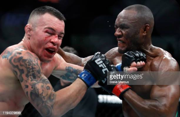 Colby Covington takes a punch from UFC welterweight champion Kamaru Usman in their welterweight title fight during UFC 245 at T-Mobile Arena on...