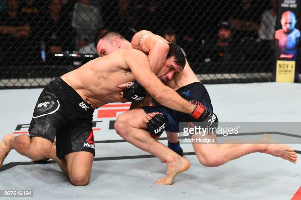 Colby Covington takes down Demian Maia of Brazil in their welterweight bout during the UFC Fight Night event inside the Ibirapuera Gymnasium on...