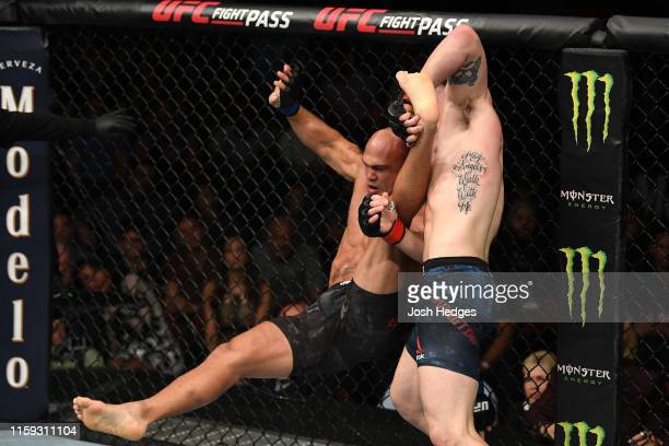 Colby Covington takes down Robbie Lawler in their welterweight bout during the UFC Fight Night event at the Prudential Center on August 3 2019 in...