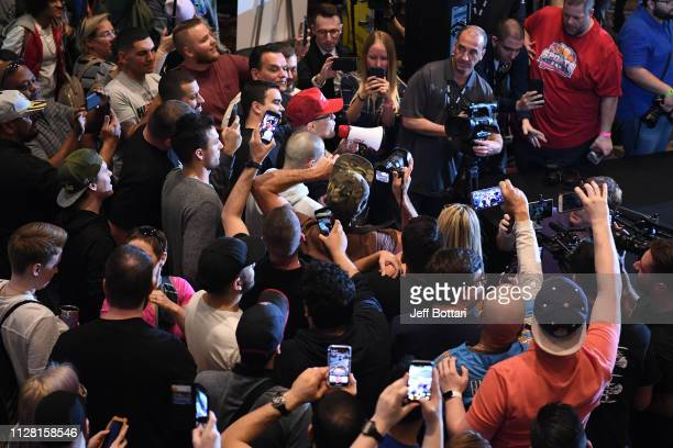 Colby Covington taunts Kamaru Usman of Nigeria as he performs an open workout for fans and media during the UFC 235 Open Workouts event at MGM Grand...