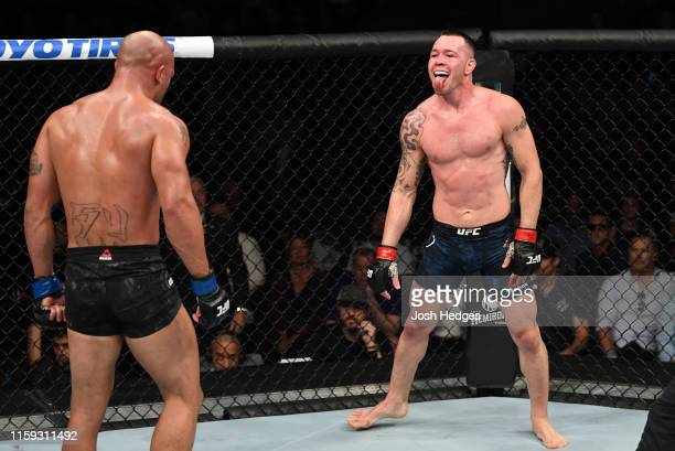 Colby Covington taunts Robbie Lawler in their welterweight bout during the UFC Fight Night event at the Prudential Center on August 3, 2019 in...