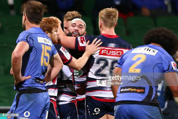Colby Fainga'a of the Rebels celebrates after crossing for a try during the round 16 Super Rugby match between the Force and the Rebels at nib...