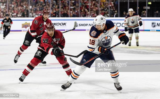 Colby Genoway of Haie challenges Ryan Strome of Edmonton during the NHL Global Series Challenge game between Edmonton Oilers and Kolner Haie at...