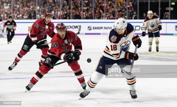 Colby Genoway of Haie challenges Ryan Strome of Edmonton during the NHL Global Series Challenge game between Edmonton Oilers and Kolner Haie at...