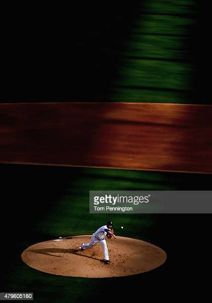 Colby Lewis of the Texas Rangers pitches against the Los Angeles Angels in the top of the first inning at Globe Life Park in Arlington on July 5 2015...