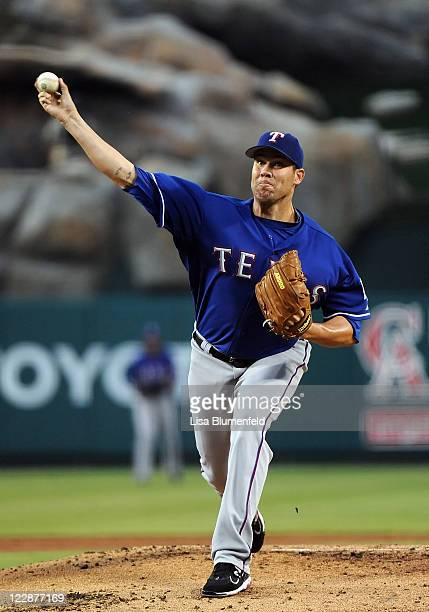 Colby Lewis of the Texas Rangers pitches against the Los Angeles Angels of Anaheim at Angel Stadium of Anaheim on August 18, 2011 in Anaheim,...