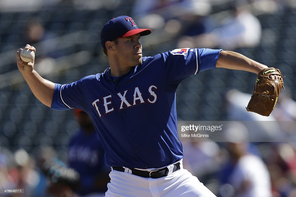 Colby Lewis #48 of the Texas Rangers pitches during the top of the first inning against the Cleveland Indians at Surprise Stadium on March 03, 2014 in Surprise, Arizona.