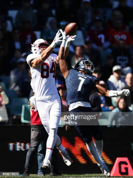 Colby Parkinson of Stanford beats Justin Bickham of Rice to a pass to score a touchdown during the College Football Sydney Cup match between Stanford...