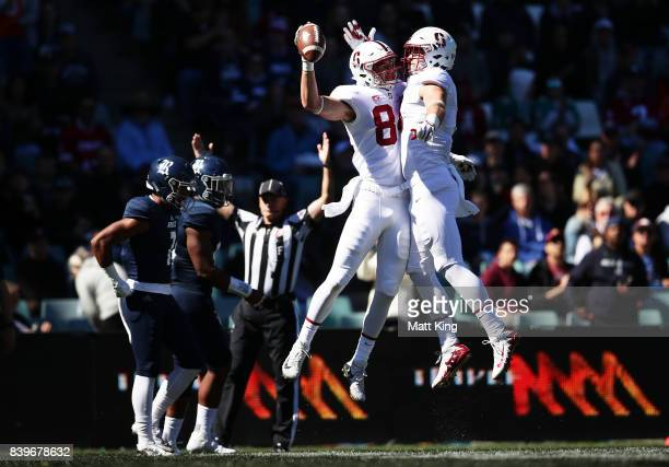 Colby Parkinson of Stanford celebrates with Dalton Schultz after scoring a touchdown during the College Football Sydney Cup match between Stanford...