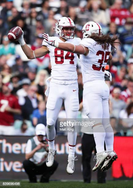 Colby Parkinson of Stanford celebrates with Daniel Marx after scoring a touchdown during the College Football Sydney Cup match between Stanford...