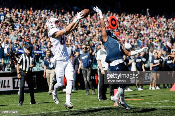 Colby Parkinson of Stanford University catches the ball for a touchdown during the College Football Sydney Cup match between Stanford University and...