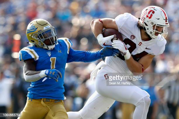 Colby Parkinson of the Stanford Cardinal hauls in a short pass play as Darnay Holmes of the UCLA Bruins defends during the first half of a game at...