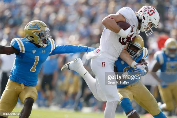Colby Parkinson of the Stanford Cardinal hauls in a short pass play as Adarius Pickett and Darnay Holmes of the UCLA Bruins defends during the first...