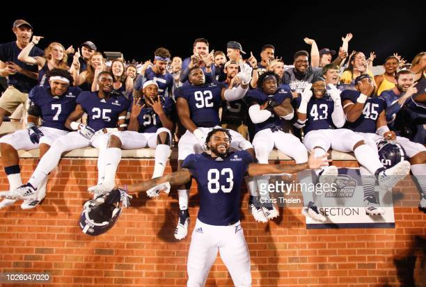 Colby Ransom of the Georgia Southern Eagles along with teammates and fans celebrate their win over the South Carolina State Bulldogs on September 1...