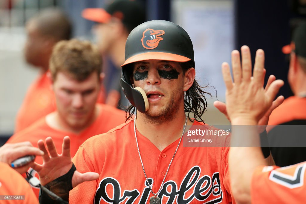 Colby Rasmus #28 of the Baltimore Orioles celebrates scoring a run during the fifth inning against the Atlanta Braves at SunTrust Park on June 23, 2018 in Atlanta, Georgia.