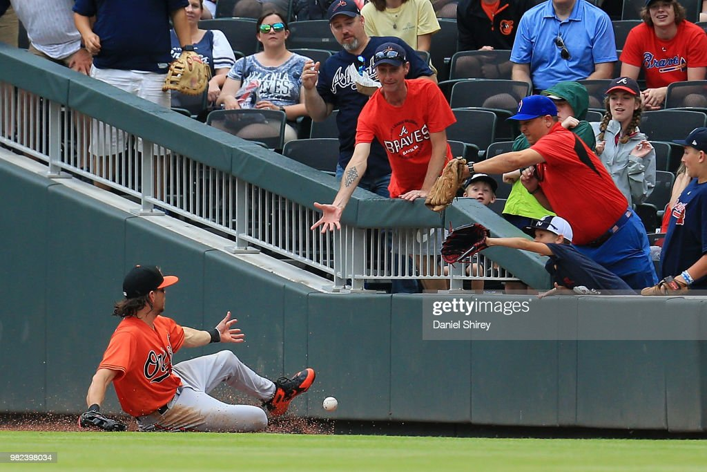 Colby Rasmus #28 of the Baltimore Orioles fails to make a foul ball during the seventh inning against the Atlanta Braves at SunTrust Park on June 23, 2018 in Atlanta, Georgia.