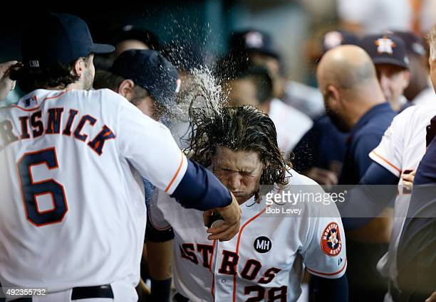 Colby Rasmus of the Houston Astros celebrates his seventh inning solo home run as Jake Marisnick throws water on him against the Kansas City Royals...
