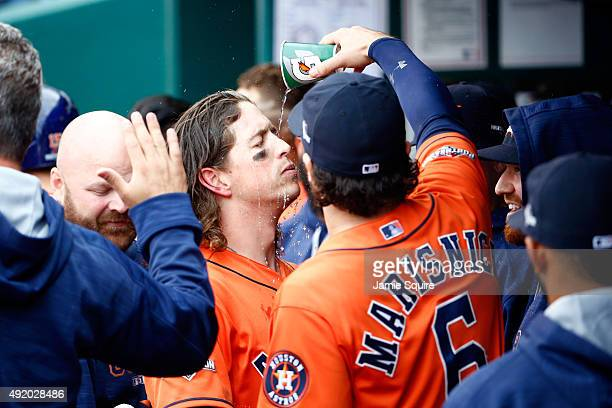 Colby Rasmus of the Houston Astros celebrates with teammate Jake Marisnick in the dugout after hitting a solo home run in the third inning against...