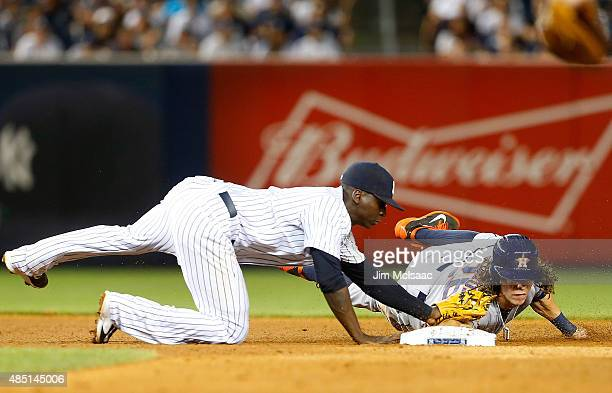 Colby Rasmus of the Houston Astros is tagged out at second base in the sixth inning by Didi Gregorius of the New York Yankees at Yankee Stadium on...