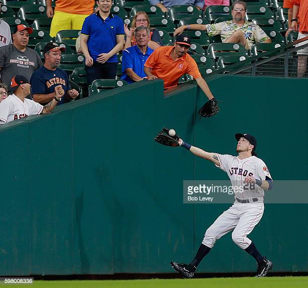 Colby Rasmus of the Houston Astros makes a catch in foul territory on a pop fly by Stephen Vogt of the Oakland Athletics in the sixth inning at...