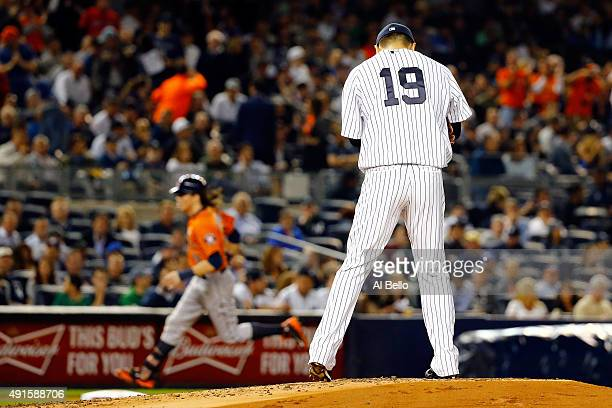 Colby Rasmus of the Houston Astros rounds the bases after scoring a solo home run against Masahiro Tanaka of the New York Yankees during the second...