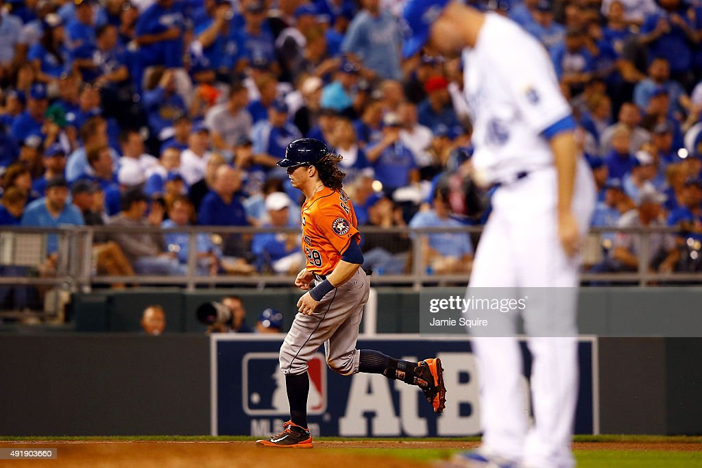 Colby Rasmus #28 of the Houston Astros runs the bases after hitting a solo home run as Ryan Madson #46 of the Kansas City Royals reacts in the eighth inning during game one of the American League Division Series at Kauffman Stadium on October 8, 2015 in Kansas City, Missouri.