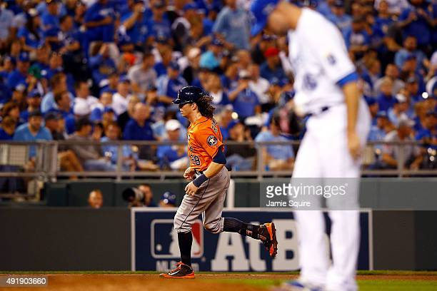 Colby Rasmus of the Houston Astros runs the bases after hitting a solo home run as Ryan Madson of the Kansas City Royals reacts in the eighth inning...