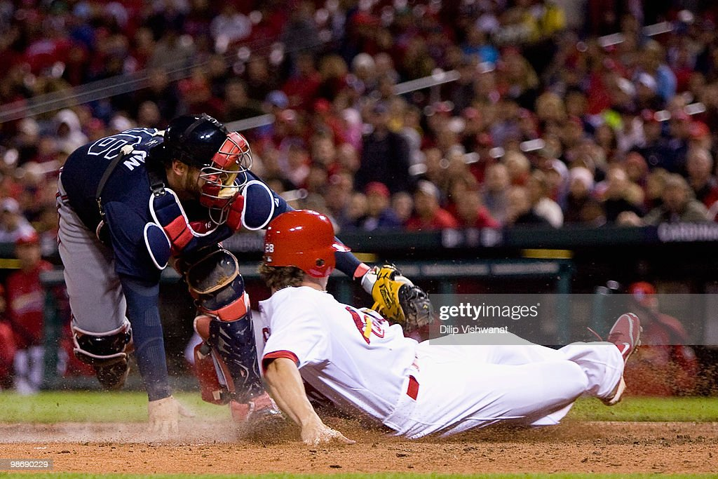 Colby Rasmus #28 of the St. Louis Cardinals is tagged out by Brian McCann #16 of the Atlanta Braves at Busch Stadium on April 26, 2010 in St. Louis, Missouri. The Cardinals beat the Braves 4-3.