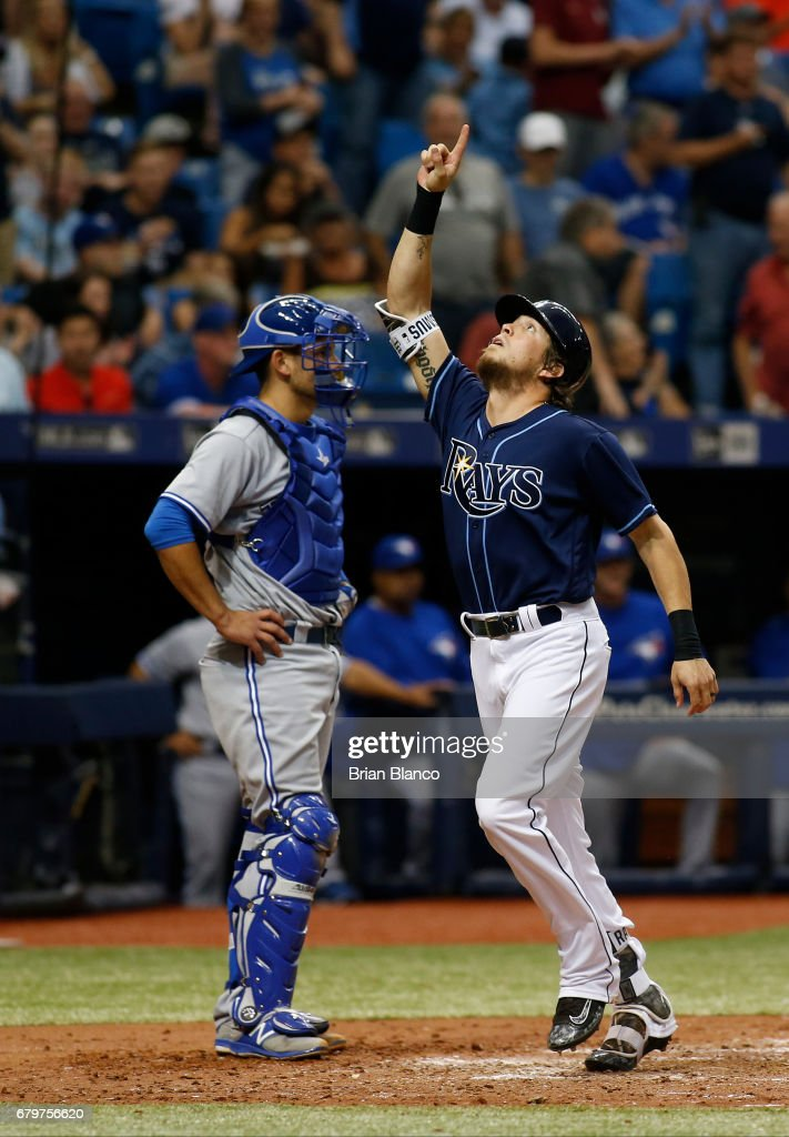 Colby Rasmus #28 of the Tampa Bay Rays celebrates his two-run home run in front of catcher Luke Maile #22 of the Toronto Blue Jays during the sixth inning of a game on May 6, 2017 at Tropicana Field in St. Petersburg, Florida.