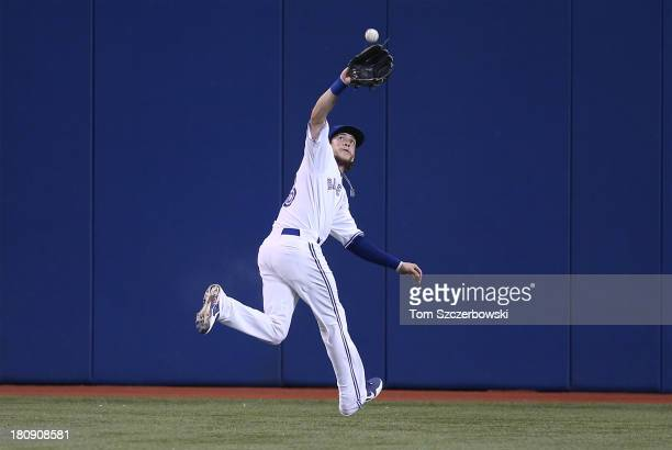 Colby Rasmus of the Toronto Blue Jays catches a fly ball in the second inning during MLB game action against the New York Yankees on September 17...
