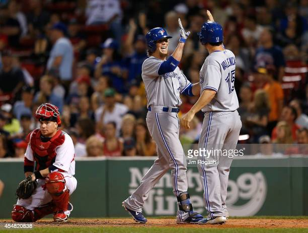 Colby Rasmus of the Toronto Blue Jays celebrates his tworun home with Danny Valencia of the Toronto Blue Jays who was on base in the seventh inning...