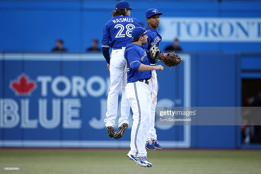Colby Rasmus #28 of the Toronto Blue Jays celebrates their victory with teammates Kevin Pillar #22 and Anthony Gose #8 during MLB game action against the Baltimore Orioles on September 14, 2013 at Rogers Centre in Toronto, Ontario, Canada.