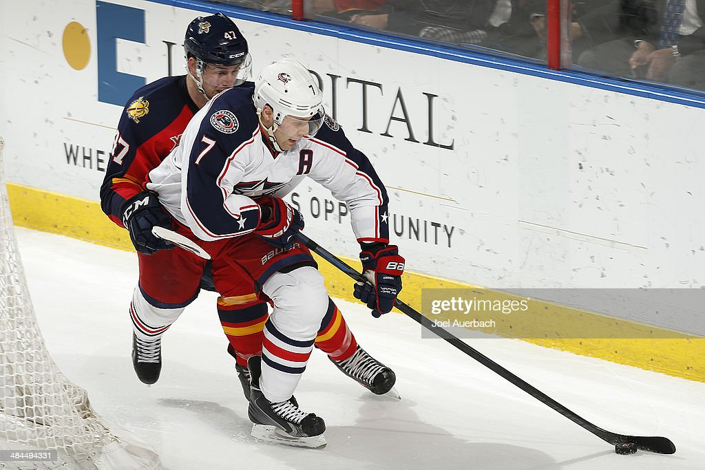 Colby Robak #47 of the Florida Panthers pursues Jack Johnson #7 of the Columbus Blue Jackets as he circles the net with the puck at the BB&T Center on April 12, 2014 in Sunrise, Florida. The Blue Jackets defeated the Panthers 3-2.