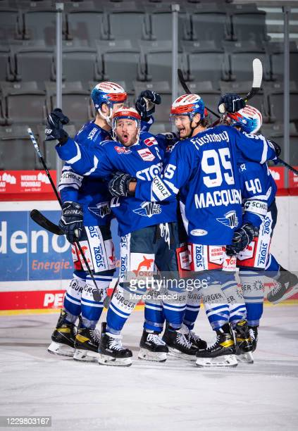 Colby Robak Travis Turnbull Jamie MacQueen and Darin Olver of the Schwenninger Wild Wings celebrate after scoring the 21 during the Magenta Sports...