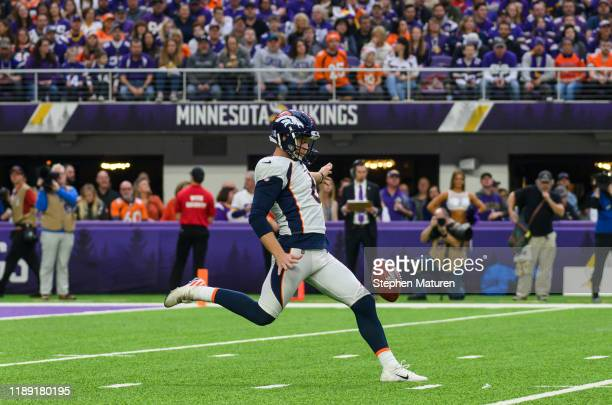 Colby Wadman of the Denver Broncos punts the ball in the first quarter of the game against the Minnesota Vikings at US Bank Stadium on November 17...