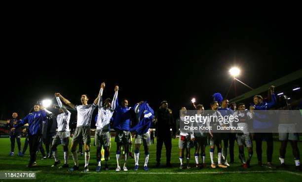 Colchester United celebrate after winning the Carabao Cup Round of 16 match between Crawley Town and Colchester United FC at The Peoples Pension...