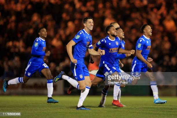 Colchester United celebrate victory in the penalty shoot out during the Carabao Cup Third Round match between Colchester United and Tottenham Hotspur...