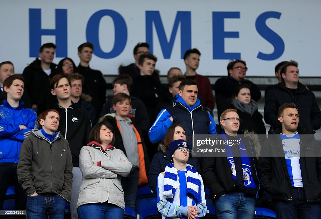 Colchester United fans look on dejected as they are relegated from League One during the Sky Bet League One match between Colchester United and Burton Albion at Colchester Community Stadium on April 23, 2016 in Colchester, England.