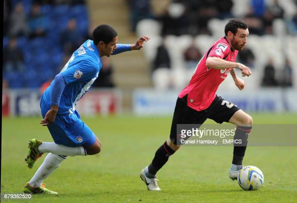Colchester United's Alex Wynter tries to catch Oldham Athletic's David Worrall
