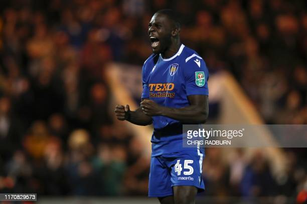 Colchester United's English striker Frank Nouble celebrates his goal in the penalty shoot out during the English League Cup third round football...