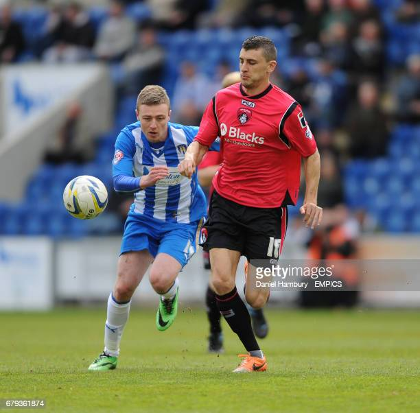 Colchester United's Freddie Sears and Oldham Athletic's David Worrall battle for the ball