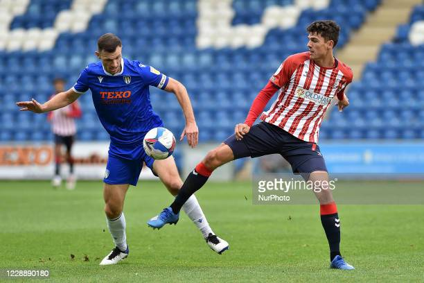 Colchester United's Tommy Smith and Oldham Athletic's George Blackwood during the Sky Bet League 2 match between Colchester United and Oldham...