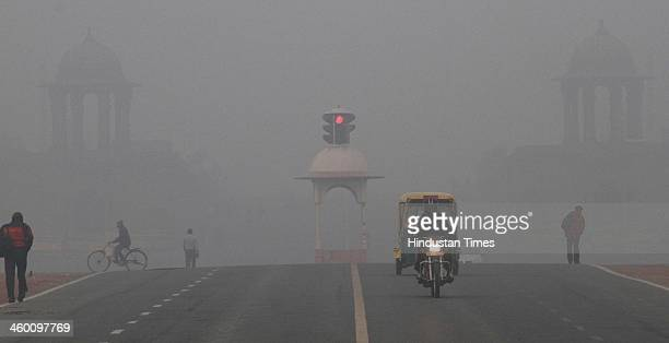 Cold and foggy day on the first day of New Year 2014 at Vijay Chowk on January 1 2014 in New Delhi India Due to clouds and rain the minimum...