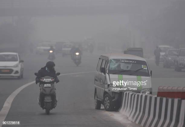 Cold and foggy weather at Mayur Vihar on January 4 2018 in New Delhi India A thick blanket of fog continued to envelope the national capital and...