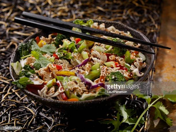 cold asian salad with crunchy (raw) ramen noodles - side salad stock pictures, royalty-free photos & images